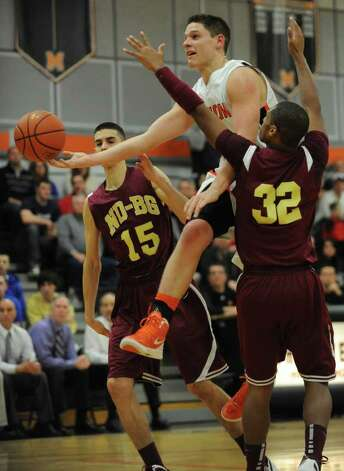 Grant Massaroni of Mohonasen drives to the basket through Kyle Garrison #15, and James Vice of Bishop-Gibbons during the Kirvin Cup boys' basketball tournament at Mohonasen High School Wednesday, Dec. 28, 2011 in Albany, N.Y. (Lori Van Buren / Times Union) Photo: Lori Van Buren