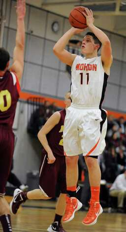 Grant Massaroni of Mohonasen takes a jump shop against Bishop-Gibbons during the Kirvin Cup boys' basketball tournament at Mohonasen High School Wednesday, Dec. 28, 2011 in Albany, N.Y. (Lori Van Buren / Times Union) Photo: Lori Van Buren