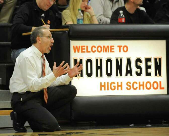 Mohonasen Head Coach Ken Dagostino yells from the sidelines during the Kirvin Cup boys' basketball t