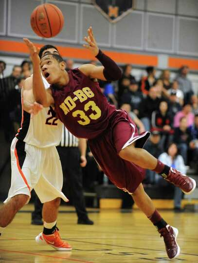 Jonathan Villanueva of Bishop-Gibbons loses the ball as he turns to the basket against Mohonasen dur