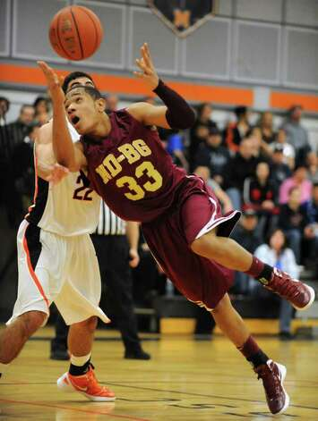 Jonathan Villanueva of Bishop-Gibbons loses the ball as he turns to the basket against Mohonasen during the Kirvin Cup boys' basketball tournament at Mohonasen High School Wednesday, Dec. 28, 2011 in Albany, N.Y. (Lori Van Buren / Times Union) Photo: Lori Van Buren
