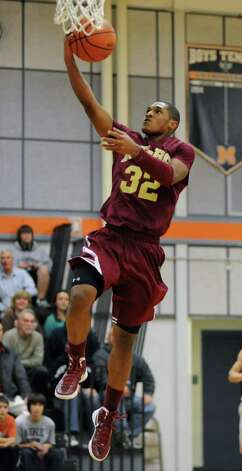 James Vice, #32, of Bishop-Gibbons makes a layup after stealing the ball from Mohonasen during the Kirvin Cup boys' basketball tournament at Mohonasen High School Wednesday, Dec. 28, 2011 in Albany, N.Y. (Lori Van Buren / Times Union) Photo: Lori Van Buren