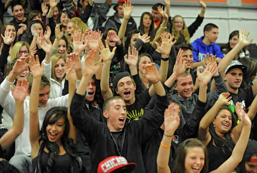 Mohonasen fans cheer during the Kirvin Cup boys' basketball tournament against Bishop-Gibbons at Moh