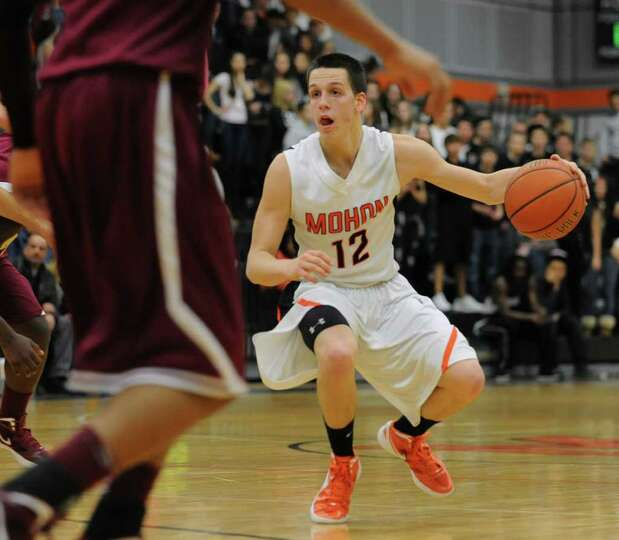 Killian Tallman, #12,  of Mohonasen dribbles the ball past Bishop-Gibbons during the Kirvin Cup boys