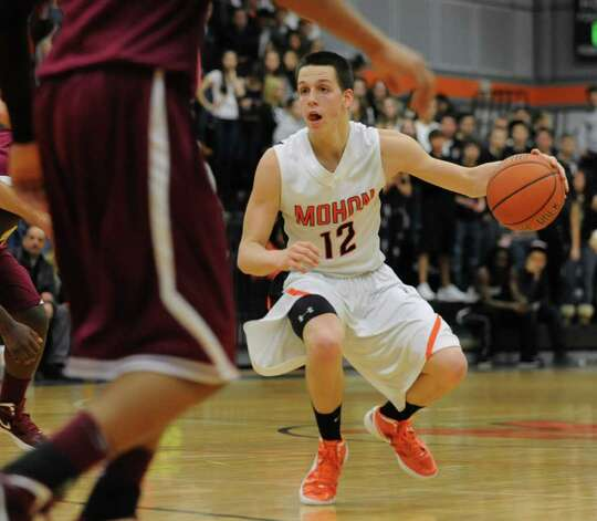 Killian Tallman, #12,  of Mohonasen dribbles the ball past Bishop-Gibbons during the Kirvin Cup boys' basketball tournament at  Mohonasen High School Wednesday, Dec. 28, 2011 in Albany, N.Y. (Lori Van Buren / Times Union) Photo: Lori Van Buren