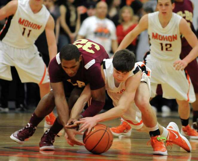 From left, James Vice of Bishop-Gibbons and Josh Giordano of Mohonasen battles for a loose ball duri