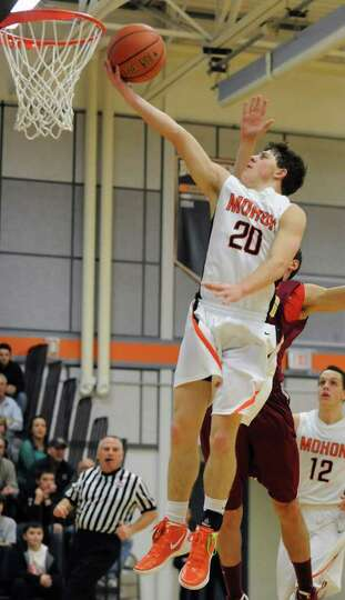 Josh Giordano of Mohonasen drives to the basket against Bishop-Gibbons during the Kirvin Cup boys' b