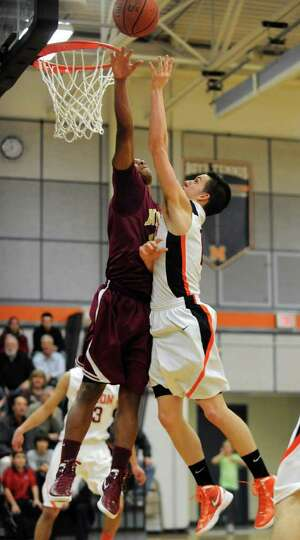From left, James Vice of Bishop-Gibbons tries to block the shot of Killian Tallman of Mohonasen duri
