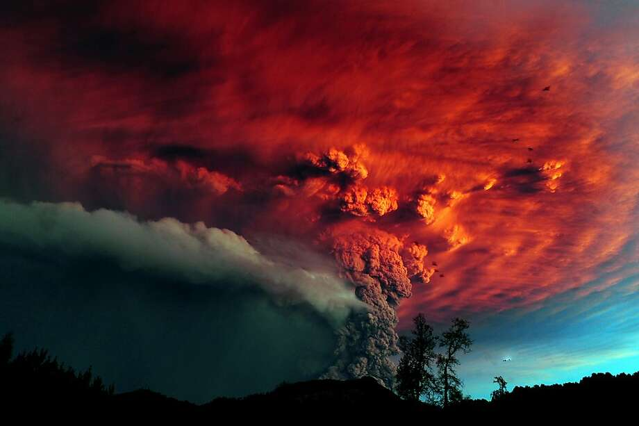 AFP PICTURES OF THE YEAR 2011 A cloud of ash billowing from Puyehue volcano near Osorno in southern Chile, 870 km south of Santiago, on June 5, 2011. Puyehue volcano erupted for the first time in half a century on June 4, 2011, prompting evacuations for 3,500 people as it sent a cloud of ash that reached Argentina. The National Service of Geology and Mining said the explosion that sparked the eruption also produced a column of gas 10 kilometers (six miles) high, hours after warning of strong seismic activity in the area.  AFP PHOTO/CLAUDIO SANTANA (Photo credit should read CLAUDIO SANTANA/AFP/Getty Images) Photo: Claudio Santana, Getty