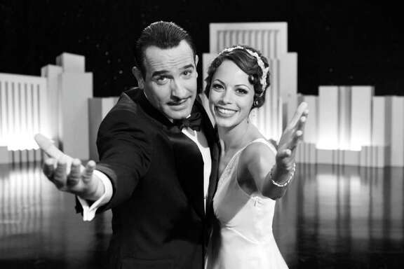 """Jean Dujardin portrays George Valentin, left, and Berenice Bejo portrays Peppy Miller in a scene from """"The Artist.""""  The film was nominated Wednesday, Dec. 14, 2011 for a screen Actors Guild Award for best ensemble cast. The 18th annual SAG Awards will be presented Jan. 29. (AP Photo/The Weinstein Company)"""