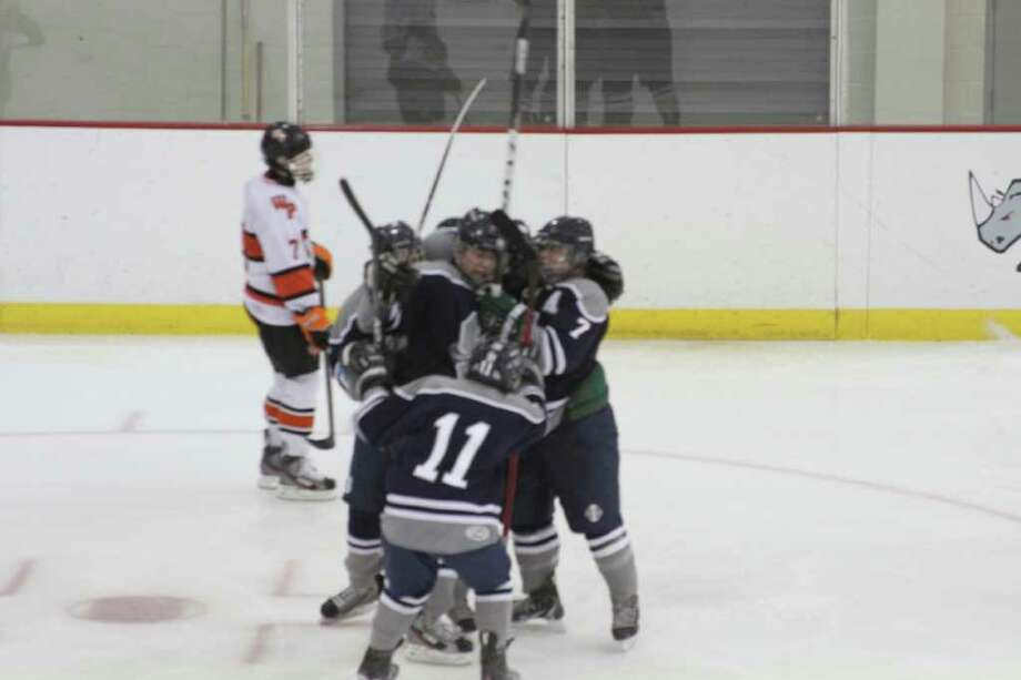 Staples celebrates Mike Lynch's game-winning goal in a 3-2 win at Watertown last Friday (Dec. 23). Photo: Contributed Photo
