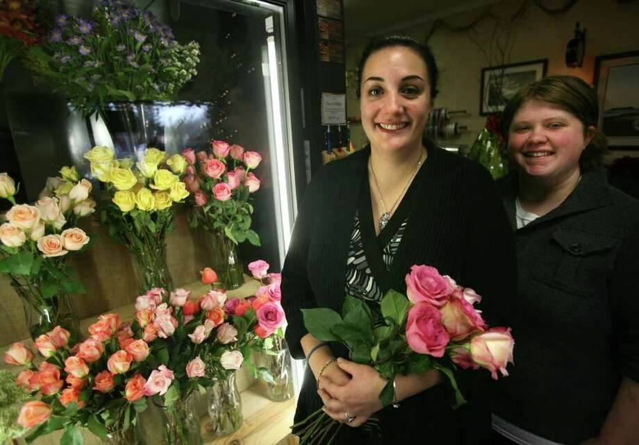 Bethany Biondi, left, and Kristen Blando, co-owners of the new Autumn Rose Flower and Gift Shop at 990 Bridgeport Avenue in Milford. Photo: Brian A. Pounds / Connecticut Post