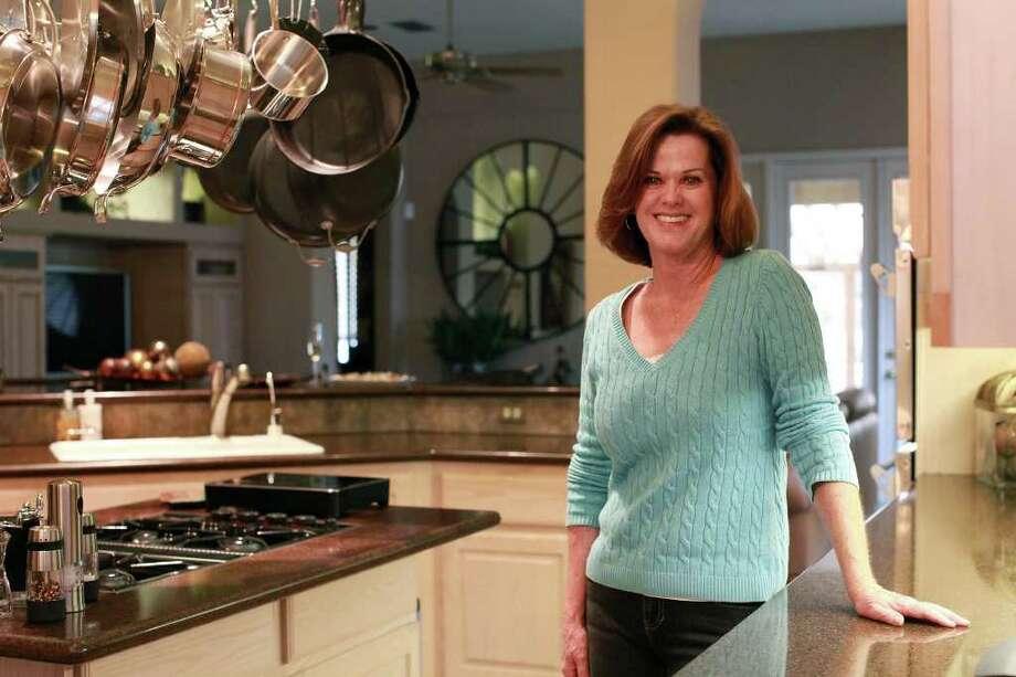 TASTE - Carol Coleman stands in her kitchen at her home in San Antonio on Friday, Dec. 23, 2011. LISA KRANTZ/lkrantz@express-news.net Photo: LISA KRANTZ, SAN ANTONIO EXPRESS-NEWS / SAN ANTONIO EXPRESS-NEWS