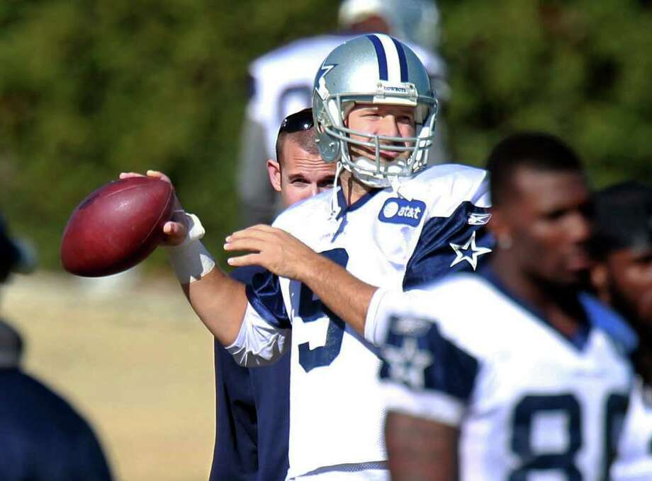 QB Tony Romo says the Cowboys have shown plenty of toughness in some road wins this season. Photo: AP
