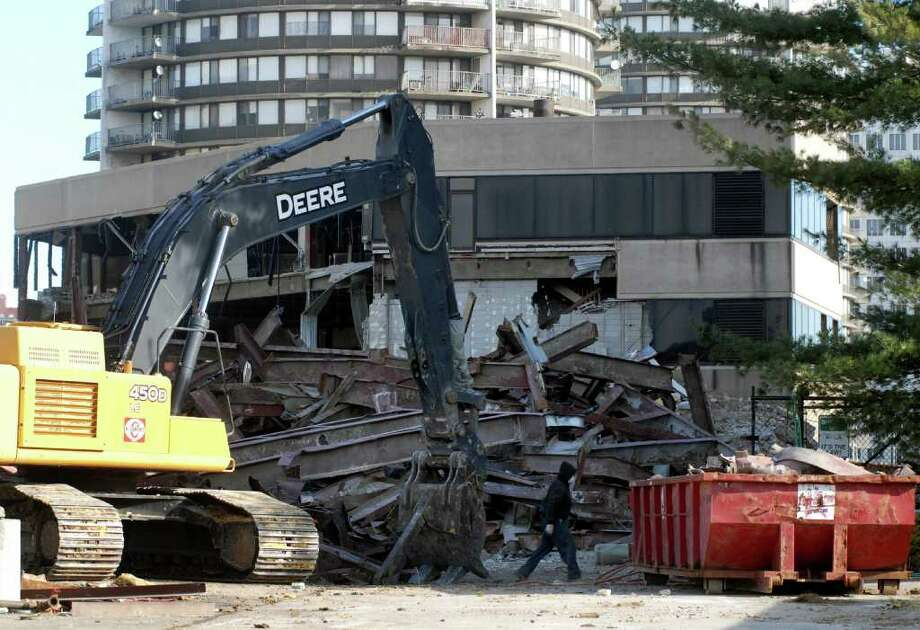 The old Advocate building at 75 Tresser Blvd in Stamford, Conn. is being torn down on Thursday December 29, 2011. Photo: Dru Nadler / Stamford Advocate Freelance