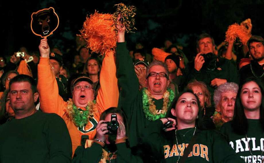Baylor fans cheer during a rally on the Riverwalk on Tuesday. Baylor will play Washington in the Alamo Bowl 2011 on  Thursday. TOM REEL/Express-News Photo: Express-News