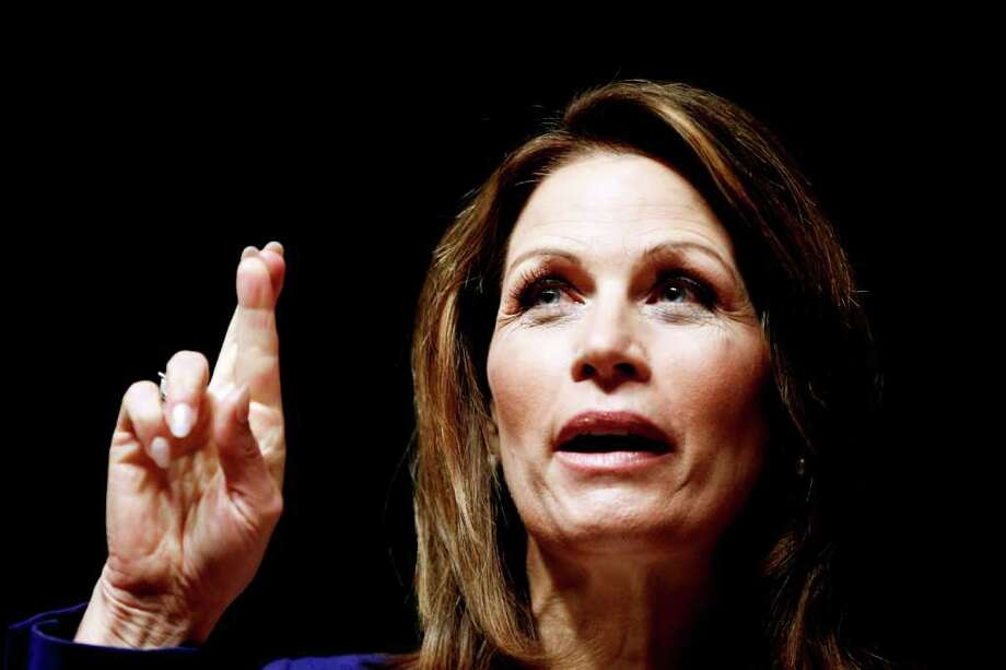 Republican presidential candidate, Rep. Michele Bachmann, R-Minn. gestures while speaking during a campaign stop at Principal Financial Group in Des Moines, Iowa, Thursday, Dec. 29, 2011. (AP Photo/Chris Carlson) Photo: Chris Carlson / AP