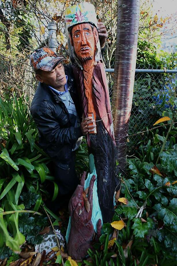 Demetrio Braceros putting up one of his sculptures at Cayuga park in San Francisco, Calif., on Wednesday, December 14, 2011. A planned $9 million restoration of Cayuga Park will include refurbishing more more than 130 wood sculptures that Braceros, a retired city gardener, did during his 20-plus years at the park. Photo: Liz Hafalia, The Chronicle