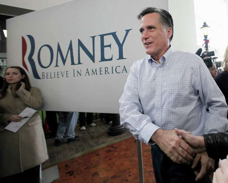 Republican presidential candidate, former Massachusetts Gov. Mitt Romney arrives at a campaign stop at the Music Man Square in Mason City, Iowa Thursday, Dec. 29, 2011. (AP Photo/Charlie Riedel) Photo: Charlie Riedel / AP