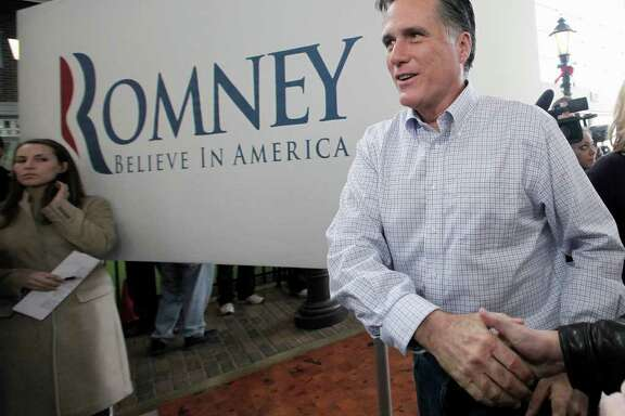 Republican presidential candidate, former Massachusetts Gov. Mitt Romney arrives at a campaign stop at the Music Man Square in Mason City, Iowa Thursday, Dec. 29, 2011. (AP Photo/Charlie Riedel)