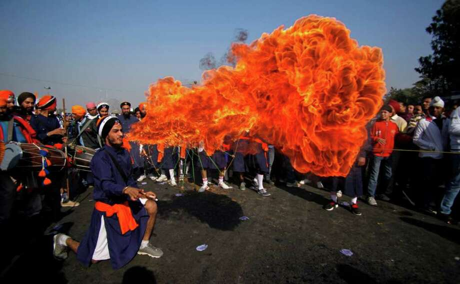 A Sikh warrior blows fire from his mouth during a religious procession ahead of the birth anniversary of Guru Gobind Singh in Jammu, India, Thursday, Dec. 29, 2011. The birth anniversary of Guru Gobind Singh, the tenth Sikh guru, will be marked on Dec. 31. Photo: Channi Anand, Associated Press / AP