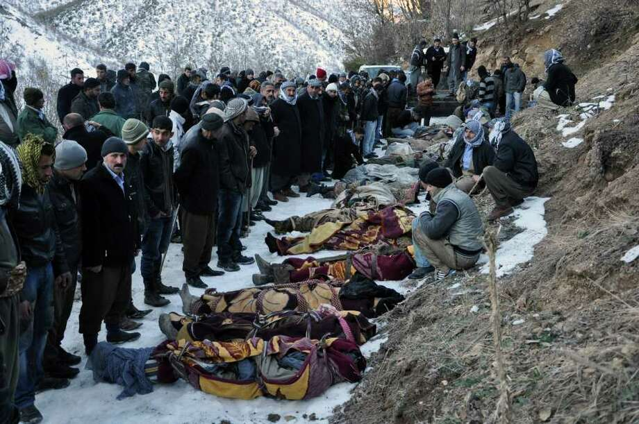 People surround bodies after Turkey's air force killed at least 35 Turkish cigarette smugglers the military mistook for separatist fighters in the Kurdish border region with Iraq. Photo: ASSOCIATED PRESS / AP