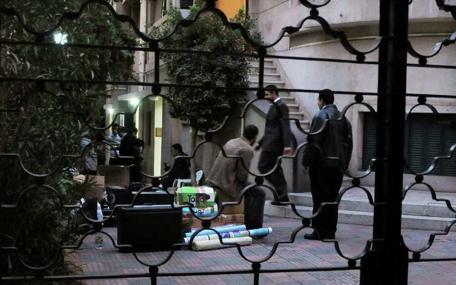 Egyptian police raid a nongovernmental organization office in Cairo, banning employees inside from leaving while they interrogate them and search through computer files. Photo: Mohammed Asad, Associated Press / AP