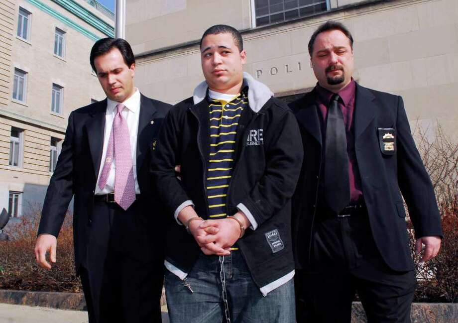 In this March 2008 file photo, Leonard Trujillo, of Worcester, Mass., center, is led from Greenwich police headquarters by Greenwich detectives on his way to criminal court in Stamford to be arraigned for the 2006 murder of Greenwich resident Andrew Kissel. In April, Trujillo was sentenced to 20 years in prison for his role in the murder. Photo: File Photo, ST / Greenwich Time File Photo