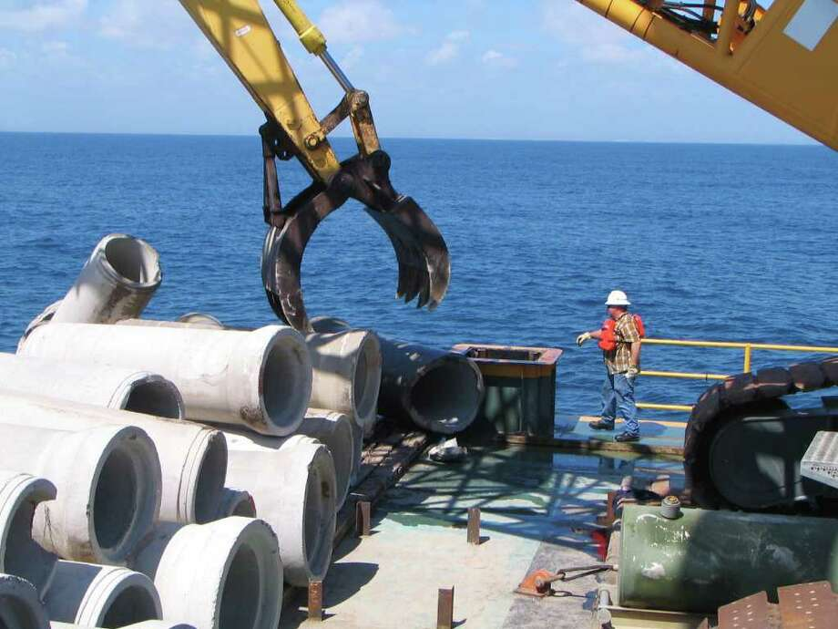 """More than 4,000 unwanted concrete culverts were """"recycled"""" for use as an artificial reef off Port Mansfield. Photo: COURTESY PHOTO"""