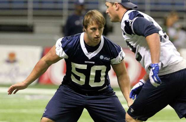 Linebacker Sean Lee (50) covers tight end Jason Witten (82) during practice at the morning session of the Dallas Cowboys training camp at the Alamodome on Friday, Aug. 5, 2011. Kin Man Hui/kmhui@express-news.net Photo: KIN MAN HUI, SAN ANTONIO EXPRESS-NEWS / SAN ANTONIO EXPRESS-NEWS