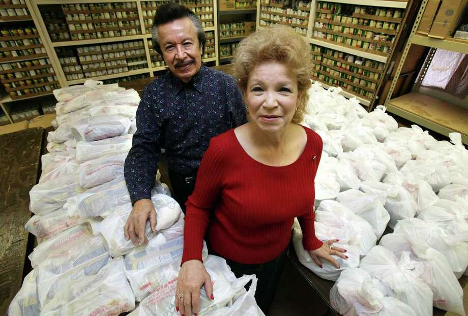 Lee Saucedo and his wife, Lali, operate the food pantry at El Divino Salvador United Methodist Church on the West Side. Photo: BOB OWEN, SAN ANTONIO EXPRESS-NEWS / rowen@express-news.net