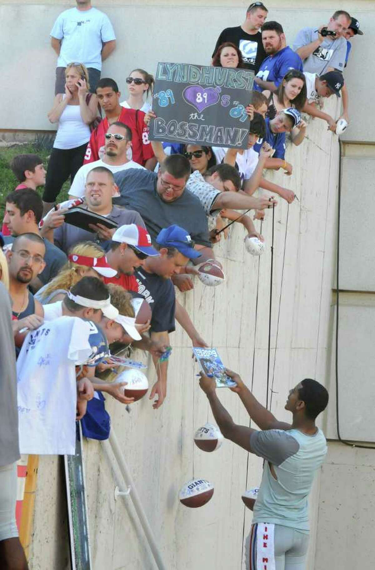 New York Giants football player Michael Johnson signs autographs after a training camp session at UAlbany in Albany, NY on August 6, 2010. Today was