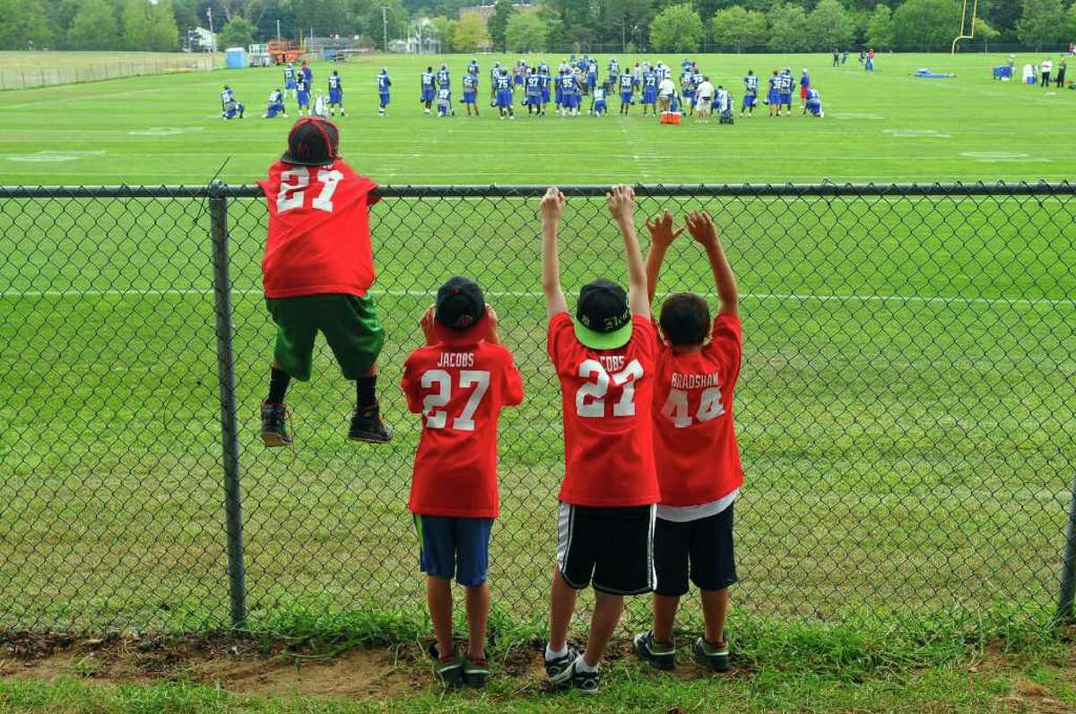 Joe DeFeciani of Clifton Park, 12, Chris Jupin of Rexford, 12, Alex Dudick of Clifton Park, 12, and Philip Mangione of Clifton Park, 8, watch the New York Giants defense practice at UAlbany in Albany, NY during training camp on Thursday afternoon August 19, 2010. ( Philip Kamrass / Times Union archive)