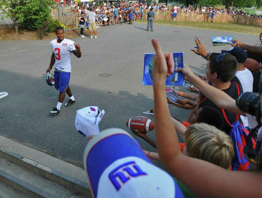 New York Giants wide receiver Victor Cruz waves to fans as he heads to the locker room after signing autographs after practice at UAlbany in Albany, NY at training camp on Thursday  afternoon August 19,  2010.  ( Philip Kamrass / Times Union  archive) Photo: Philip Kamrass / 00009902B