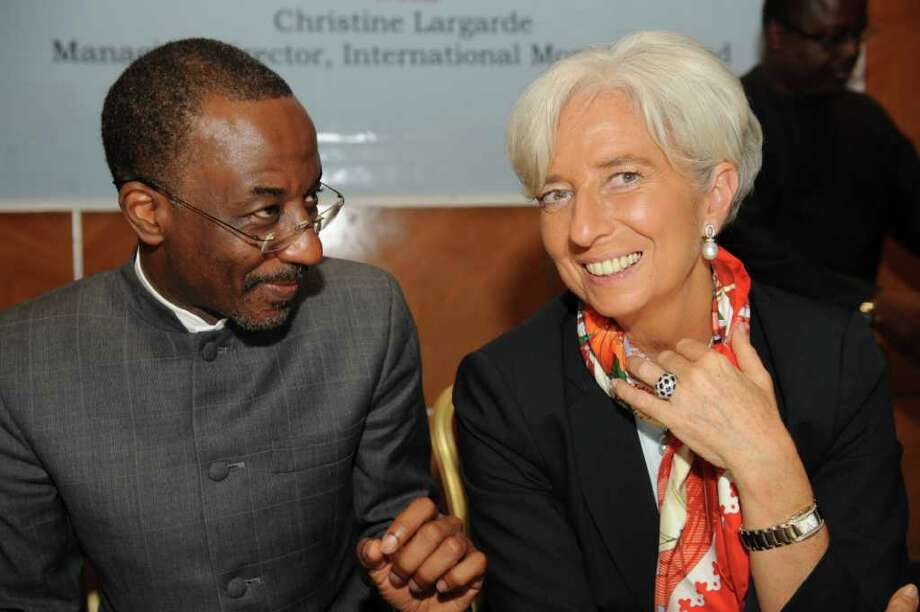 "IMF Managing Director Christine Lagarde (R) talks with Nigeria's Central Bank Governor  Lamido Sanusi Lamido  during a roundtable on ""Africa's Future: Responding to today's Global Economic Challenges"" organised by the Nigerian Economic Summit Group in Lagos on December 20, 2011. The world economy is at a ""very dangerous juncture"", IMF chief Christine Lagarde said on Tuesday referring to the potential impact on poorer nations during her first visit to Africa as head of the fund. AFP PHOTO / PIUS UTOMI EKPEI (Photo credit should read PIUS UTOMI EKPEI/AFP/Getty Images) Photo: PIUS UTOMI EKPEI / AFP"