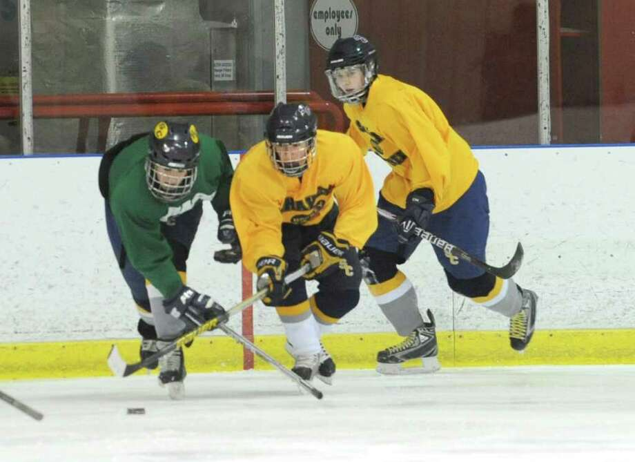The Colonie/Shaker hockey team practices on the Albany County Hockey Facility rink on Tuesday, Dec. 27, 2011 in Albany, N.Y. (Lori Van Buren / Times Union) Photo: Lori Van Buren