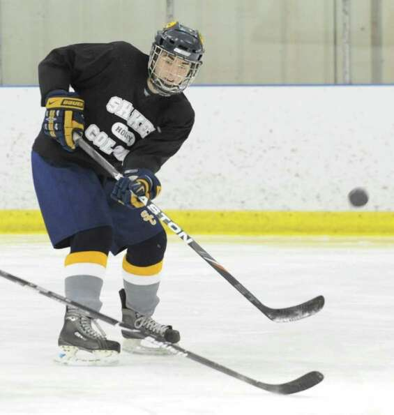 Matt O'Connell practices with the Colonie/Shaker hockey team on the Albany County Hockey Facility ri