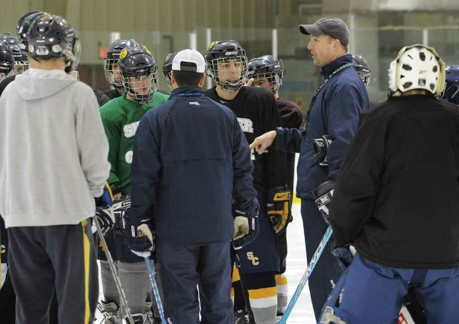 Coach Steve Hudak talks to the players on the Colonie/Shaker hockey team as they practice on the Albany County Hockey Facility rink on Tuesday, Dec. 27, 2011 in Albany, N.Y. (Lori Van Buren / Times Union) Photo: Lori Van Buren