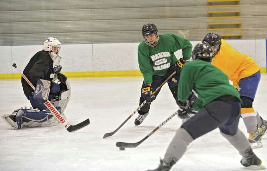Eric Egan, second from left, skates with the Colonie/Shaker hockey team as they practice on the Albany County Hockey Facility rink on Tuesday, Dec. 27, 2011 in Albany, N.Y. (Lori Van Buren / Times Union) Photo: Lori Van Buren