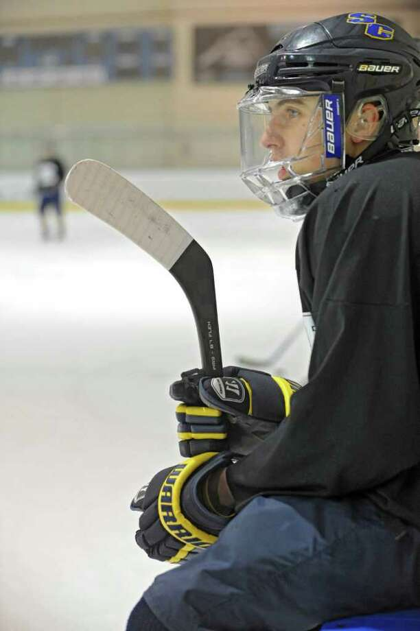 Andrew Serafino waits to join a drill with the Colonie/Shaker hockey team as they practice on the Albany County Hockey Facility rink on Tuesday, Dec. 27, 2011 in Albany, N.Y. (Lori Van Buren / Times Union) Photo: Lori Van Buren