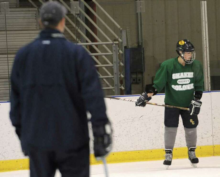 Joey Chiara, right,  runs a drill with the Colonie/Shaker hockey team as they practice on the Albany County Hockey Facility rink on Tuesday, Dec. 27, 2011 in Albany, N.Y. (Lori Van Buren / Times Union) Photo: Lori Van Buren