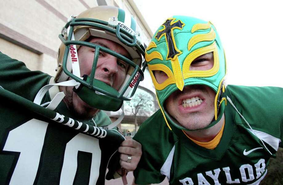 Chris Fuentes (left) and Peter Collier, fans from Waco, walk around outside as Baylor plays Washington in the Valero Alamo Bowl 2011 at the Alamodome  on December 29, 2011 Tom Reel/Staff Photo: TOM REEL, Express-News / © 2011 San Antonio Express-News