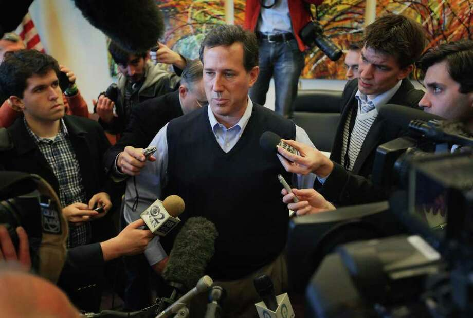 SCOTT OLSON: GETTY IMAGES LATE SURGE?:  Republican presidential candidate Rick Santorum speaks to reporters Thursday after an appearance in Coralville, Iowa. His campaign could be gaining momentum. Photo: Scott Olson / 2011 Getty Images