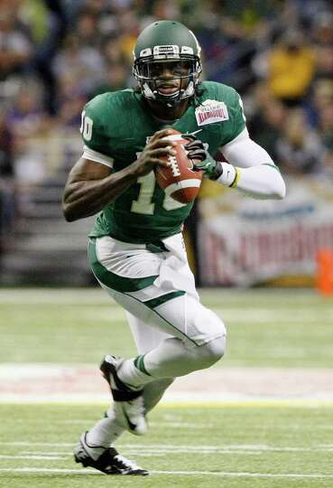 Baylor quarterback Robert Griffin III looks to pass during the first half of the Alamo Bowl 2011 aga