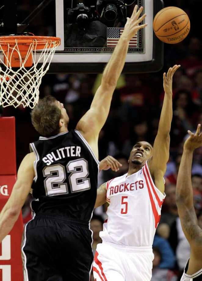 San Antonio Spurs' Tiago Splitter (22) blocks the shot of Houston Rockets' Courtney Lee (5) during the second quarter of an NBA basketball game, Thursday, Dec. 29, 2011, in Houston. (AP Photo/David J. Phillip) Photo: Associated Press
