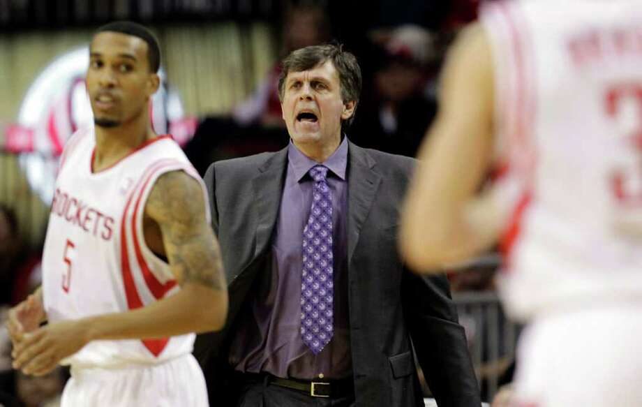 Houston Rockets coach Kevin McHale, center, calls to his players during the second quarter of an NBA basketball game against the San Antonio Spurs, Thursday, Dec. 29, 2011, in Houston. (AP Photo/David J. Phillip) Photo: Associated Press