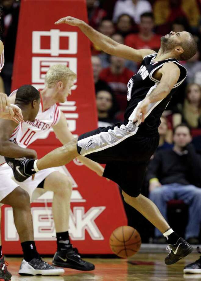 San Antonio Spurs' Tony Parker (9), of France, loses the ball while driving to the basket during the third quarter of an NBA basketball game against the Houston Rockets, Thursday, Dec. 29, 2011, in Houston. The Rockets won 105-85. (AP Photo/David J. Phillip) Photo: Associated Press