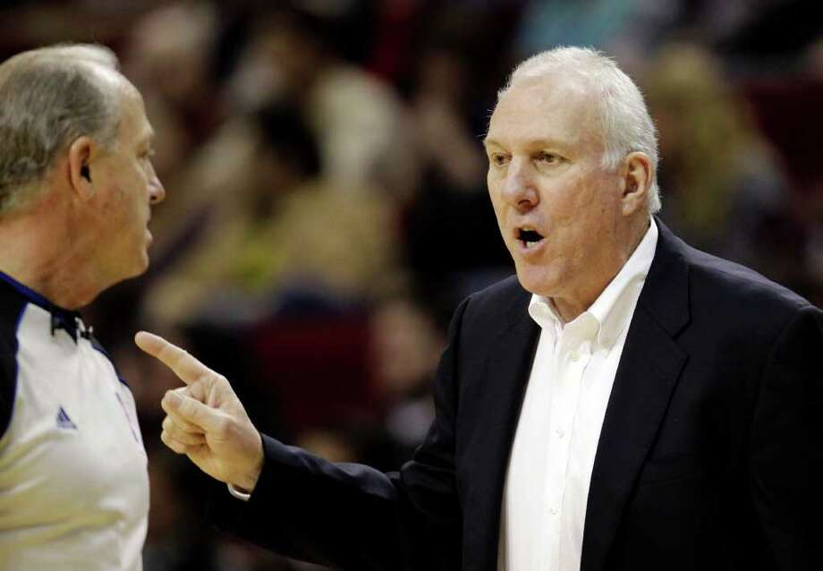 San Antonio Spurs coach Gregg Popovich, right, talks to official Kevin Fehr, left, during the second quarter of an NBA basketball game against the Houston Rockets, Thursday, Dec. 29, 2011, in Houston. (AP Photo/David J. Phillip) Photo: Associated Press