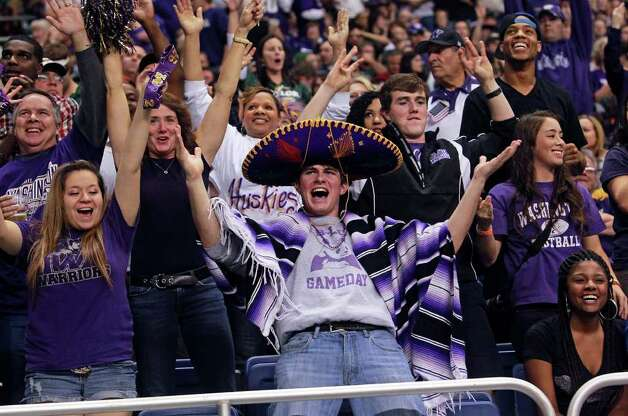 Huskies fans celebrate on the go ahead touchdown in the second quarter as Baylor plays Washington in the Valero Alamo Bowl 2011 at the Alamodome in San Antonio, Texas  on December 29, 2011 Tom Reel/Staff Photo: TOM REEL, Express-News / © 2011 San Antonio Express-News
