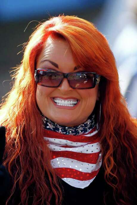 FILE-   In this Sunday, Dec. 11, 2011 file photo, Wynonna Judd waits on the sidelines before singing the national anthem at an NFL football game between the New Orleans Saints and the Tennessee Titans in Nashville, Tenn. Judd is engaged to her boyfriend, the drummer for the country group Highway 101.  Judd, 47, and Cactus Moser, 54, got engaged Dec. 24.    (AP Photo/Wade Payne, File) Photo: Wade Payne / AP2011
